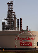 An Exxon Mobil Corp logo is painted on a storage tank at the Exxon Mobil refinery November 1 2007 in Joliet Illinois The oil company reported a...