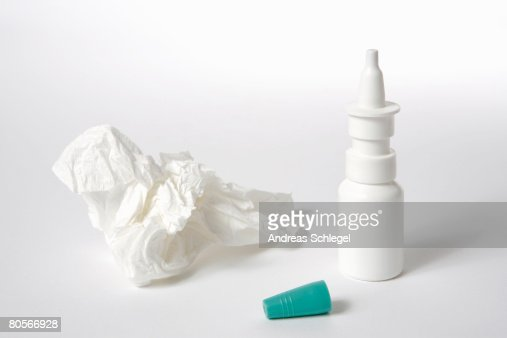 An eyedropper and tissue
