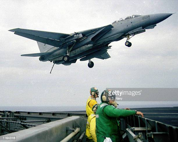 An F14 Tomcat prepares to land on the flight deck of USS Theodore Roosevelt June 81999 in the Adriatic Sea The carrier left port in Norfolk Virginia...