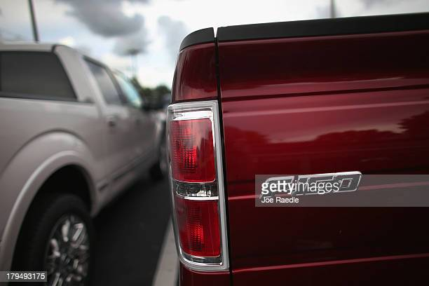 An F150 pickup is seen on the sales lot at a Ford AutoNation car dealership on September 4 2013 in North Miami Florida Ford announced it sold 221270...