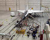 An F-15B testbed aircraft undergoes ground vibration testing.