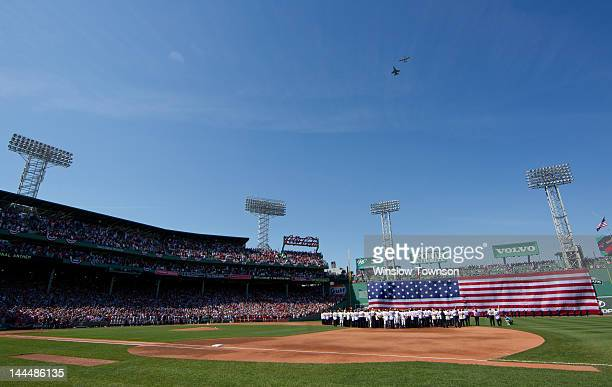 An F16 and a World War II era P51 flyover Fenway Park during ceremonies before the game between the Boston Red Sox and the New York Yankees on Friday...