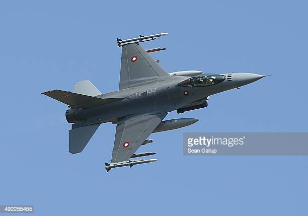 An F16 fighter plane of the Royal Danish Air Force simulates an attack during a demonstration while participating in the NATO 'Spring Storm' military...