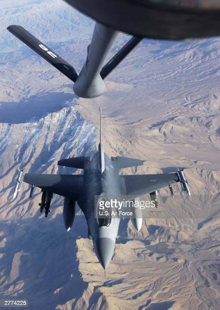 An F16 Fighting Falcon from the 174th Fighter Wing Syracuse New York receives fuel from a KC135 from the 192nd Air Refueling Wing Fairchild Air Force...