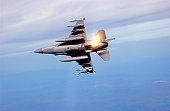 An F-16 Fighting Falcon from the Ohio Air National Guard's 180th Fighter Wing drops flares while performing maneuvers at Exercise Northern Edge 2006 at Eielson Air Force Base, Alaska, on Friday, June 9, 2006.