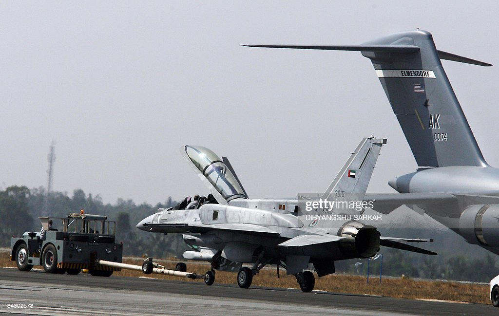 An F-16 IN Super Viper which suffred an tyre burst while landing is towed away at the Yelahanka Air Force Station during the final day of the Aero India 2009 exhibition in Bangalore on February 15, 2009. South Asia's biggest airshow opened on February 11 with firms from 25 countries showcasing their latest hardware in a chase for multibillion-dollar contracts with the Indian military. AFP PHOTO/Dibyangshu SARKAR