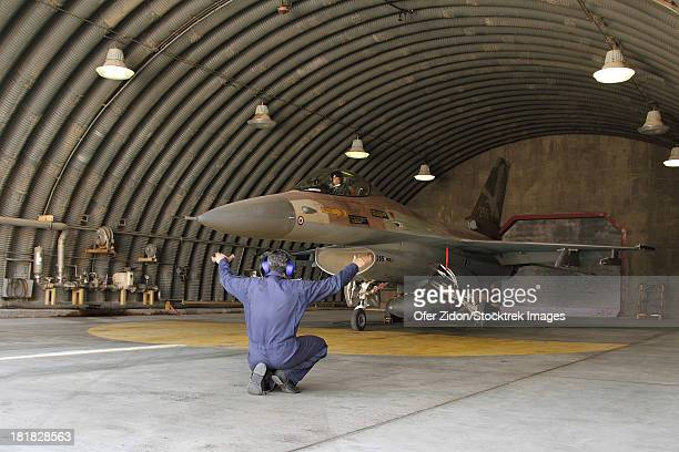 An F-16A Netz of the Israeli Air Force ready to depart its hardened shelter at Nevatim Air Force Base, Israel.