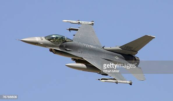 An F16C Fighting Falcon flies by during a US Air Force firepower demonstration at the Nevada Test and Training Range September 14 2007 near Indian...
