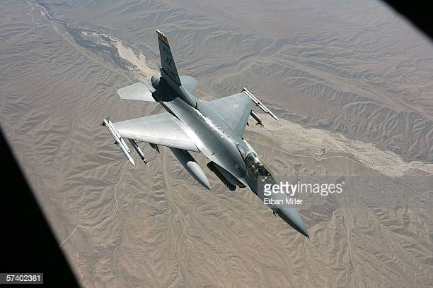 An F16C Fighting Falcon from the Arizona Air National Guard pulls away from a KC135 air refueling jet as the aircraft participate in the Joint...