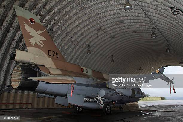 An F-16D Barak of the Israeli Air Force armed with JDAM bomb on a five minutes alert in its hardened shelter at Ramat David Air Force Base in Israel.