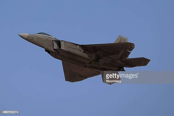 An F22 Raptor fighter jet manufactured by Lockheed Martin Corp performs an aerial display on the opening day of the 14th Dubai Air Show at Dubai...