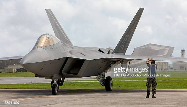 An F-22 Raptor from Langley Air Force Base, Virginia, goes through pre-flights checks before taking off on a training mission at Kadena Air Base, Okinawa, Japan.