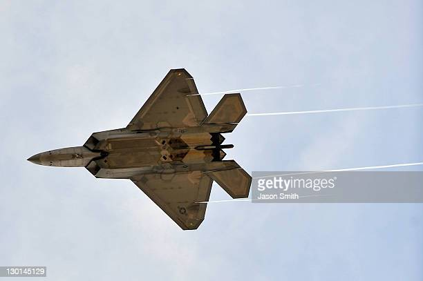 An F22 Raptors flys over the track prior to the NASCAR Sprint Cup Series Good Sam Club 500 at Talladega Superspeedway on October 23 2011 in Talladega...