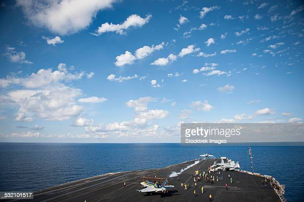 An F/A-18C Hornet launches from the flight deck of USS Nimitz.