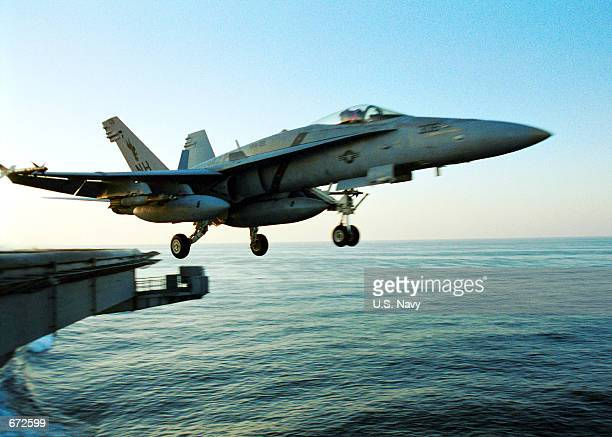 An F/A18C 'Hornet' launches November 17 2001 from the deck of the aircraft carrier USS Carl Vinson The Vinson and her carrier airwing are deployed in...