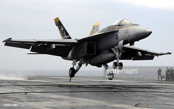 An F/A18E Super Hornet lands on the deck of the USS George Washington during a joint US and South Korea military exercise on the Korean Peninsula's...