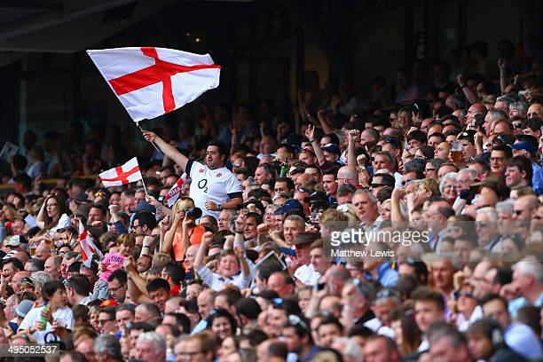 An fan holds up an England flag during the Rugby Union International Match between England and The Barbarians at Twickenham Stadium on June 1 2014 in...