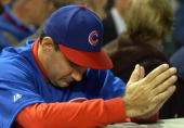 An fan waits for the final outs between the Florida Marlins and the Chicago Cubs during game seven of the National League Championship Series October...