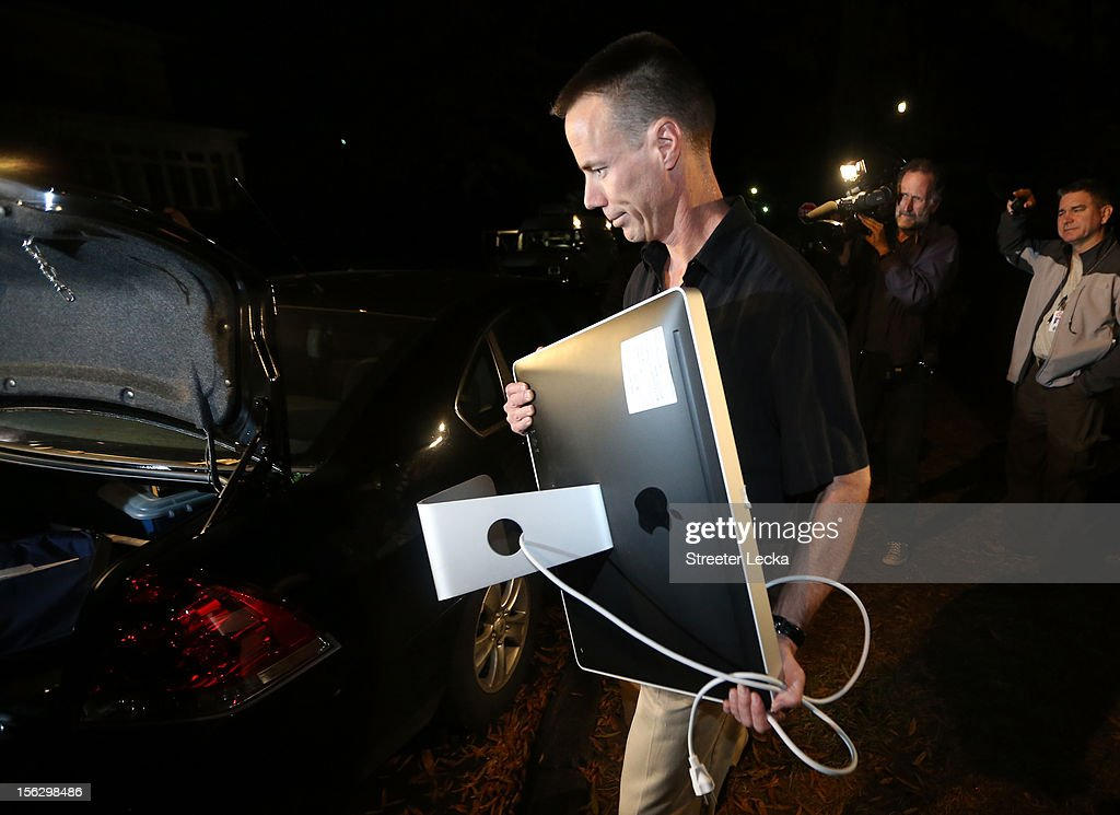 An FBI agent carries out a computer after a search of the home of Paula Broadwell on November 13, 2012 in the Dilworth neighborhood of Charlotte, North Carolina. Broadwell is the recently discovered mistress of CIA Director David Petraeus, which has led to his resignation in light of the scandal.