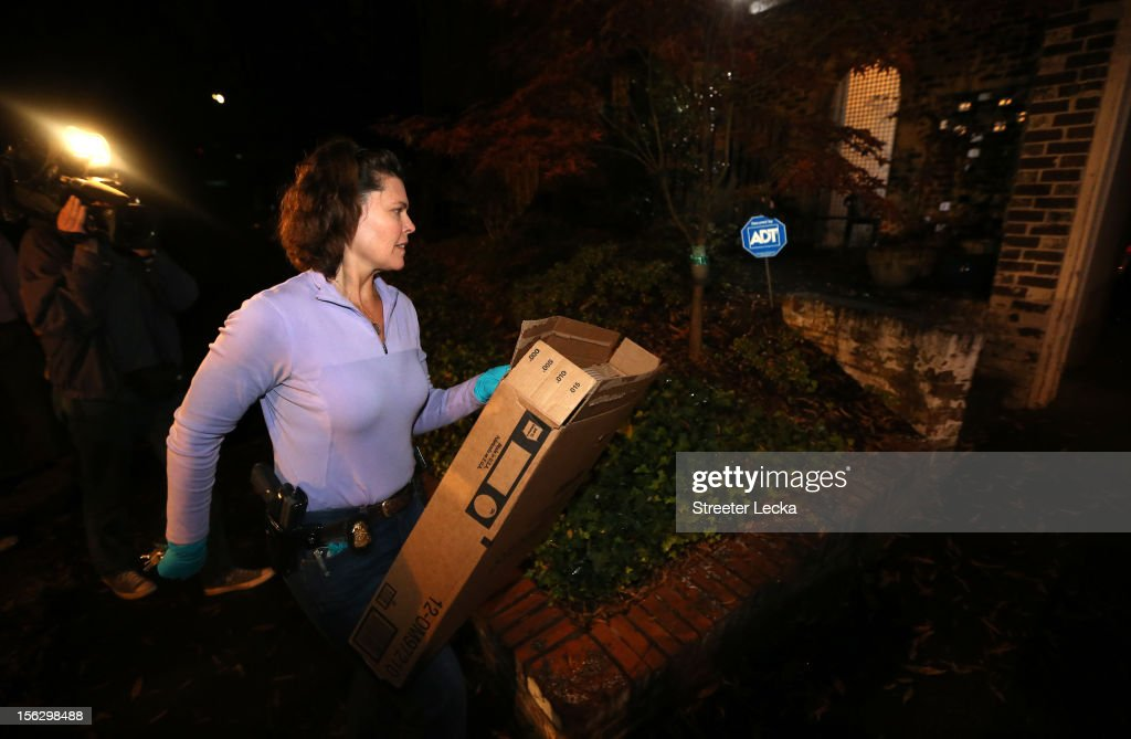 An FBI agent removes a box after a search of the home of Paula Broadwell on November 13, 2012 in the Dilworth neighborhood of Charlotte, North Carolina. Broadwell is the recently discovered mistress of CIA Director David Petraeus, which has led to his resignation in light of the scandal.