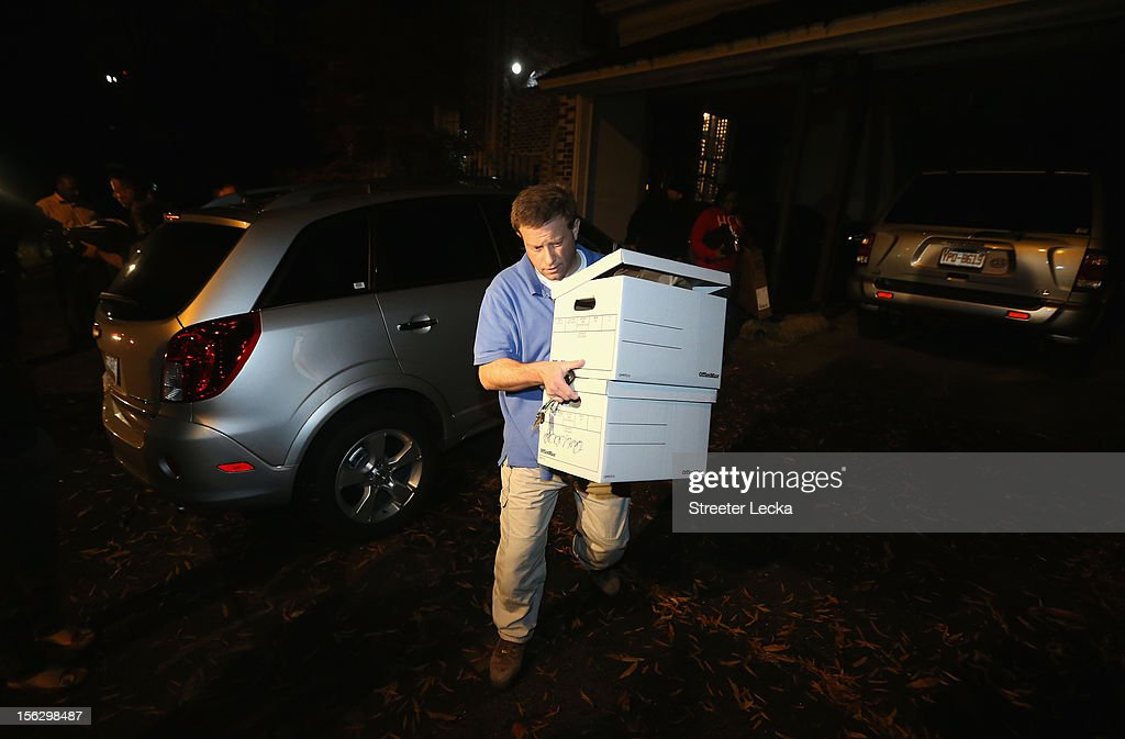 An FBI agent removes boxes after a search of the home of Paula Broadwell on November 13, 2012 in the Dilworth neighborhood of Charlotte, North Carolina. Broadwell is the recently discovered mistress of CIA Director David Petraeus, which has led to his resignation in light of the scandal.