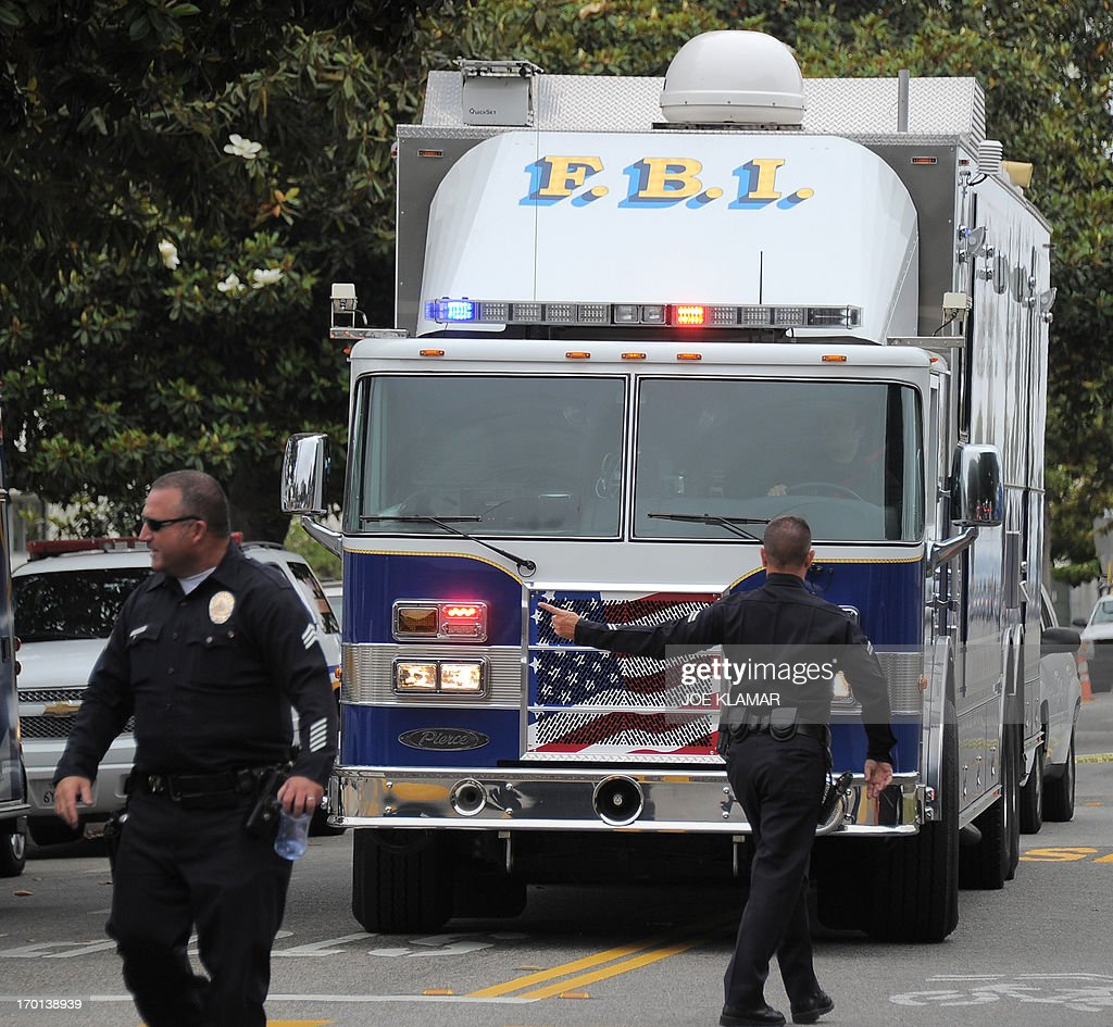 An FBI Mobile Command Center vehicle enters the grounds of Santa Monica College after multiple shootings were reported on the campus June 7 2013 in...