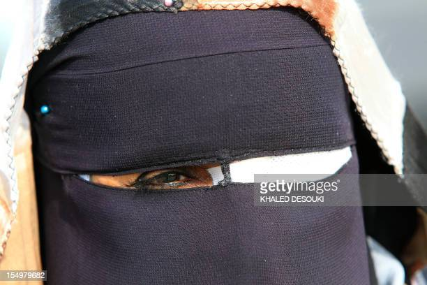 An fullyveiled Egyptian woman with an eyepatch protests outside the police academy during the trial of ousted president Hosni Mubarak on the...