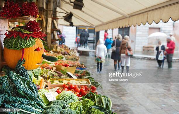 An Halloween pumpkin is displayed on a stall at Rialto market during ahigh tide on October 27 2012 in Venice Italy The high tide or acqua alta as it...
