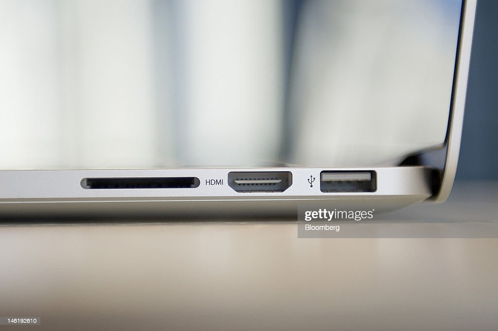 An HDMI port and USB 3 port are displayed for a photograph on Apple Inc.'s new MacBook Pro with retina display in San Francisco, California, U.S., on Monday, June 11, 2012. Apple is releasing a fresh lineup of computers and software tools to woo consumers and keep developers making applications amid accelerating rivalry from Google Inc., Microsoft Corp. and, now, Facebook Inc. Photographer: David Paul Morris/Bloomberg via Getty Images