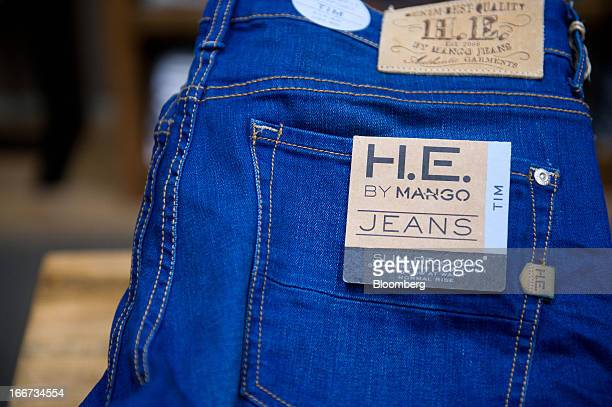 An HE By Mango label is seen on a pair of denim jeans for sale inside a Mango fashion store in Barcelona Spain on Tuesday April 16 2013 Mango has...