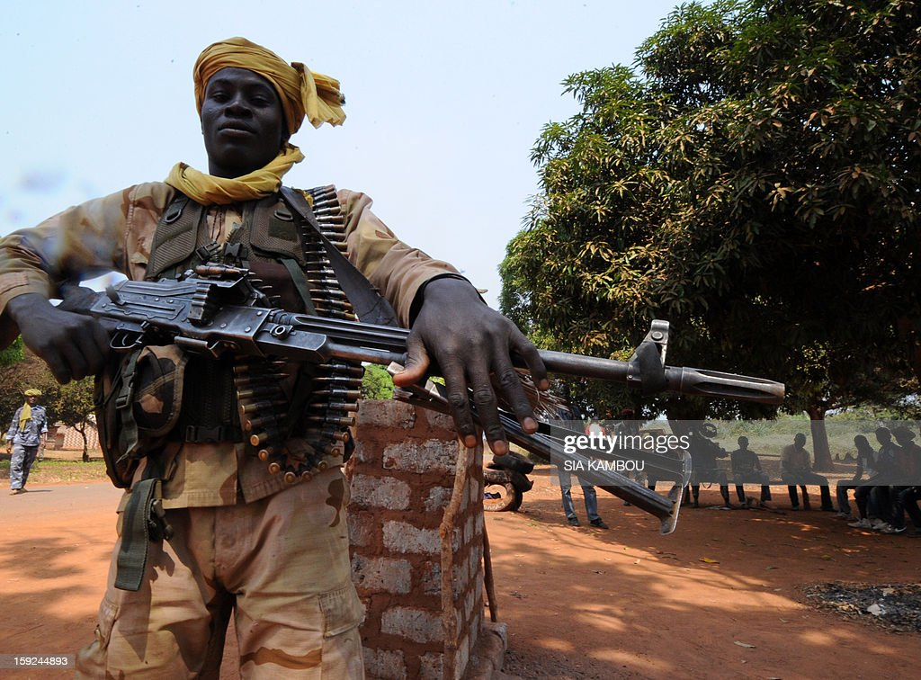 An heavily armed Seleka rebel coalition member, which launched a major offensive last month, holds on January 10, 2013 a position in a village 12 kilometers from Damara, where troops of the regional African force FOMAC are stationned. Three-way peace talks between the Central African government, the rebel coalition that conquered much of the country over the past month and the political opposition began on January 9 in Gabon. With a lightning advance starting December 10, the rebels took over most of the Central African Republic. They are demanding that Central African President Francois Bozize step down, but the head of state, who took power in a 2003 coup, warned on the eve of the talks that he would not leave his job. AFP PHOTO/ SIA KAMBOU