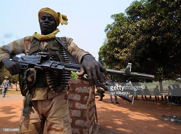 An heavily armed Seleka rebel coalition member which launched a major offensive last month holds on January 10 2013 a position in a village 12...