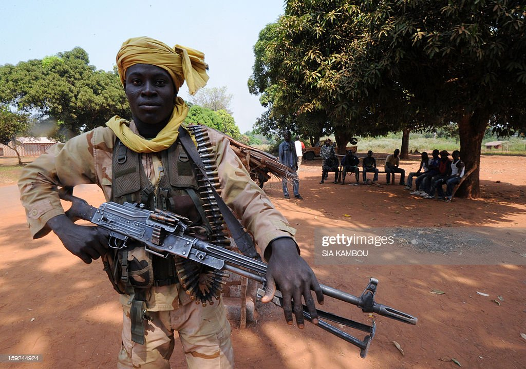 An heavily armed Seleka rebel coalition member, which launched a major offensive last month, holds on January 10, 2013 a position in a village 12 kilometers from Damara, where troops of the regional African force FOMAC are stationned. Three-way peace talks between the Central African government, the rebel coalition that conquered much of the country over the past month and the political opposition began on January 9 in Gabon. With a lightning advance starting December 10, the rebels took over most of the Central African Republic. They are demanding that Central African President Francois Bozize step down, but the head of state, who took power in a 2003 coup, warned on the eve of the talks that he would not leave his job.
