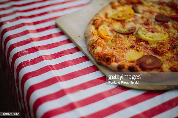 An heirloom tomato and cheese pizza before the Damariscotta River Association volunteer dinner in Damariscotta ME on Tuesday September 9 2014