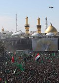 An helicopter flies over the shrine of Imam Hussein one of Shiite Islam's most revered figures as Iraqi Shiite Muslims gather during the Ashura...