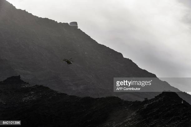An helicopter of the Civil safety flies past the Gouter mountain refuge and over the 'couloir du Goûter' on the 'voie royale' route to climb atop the...