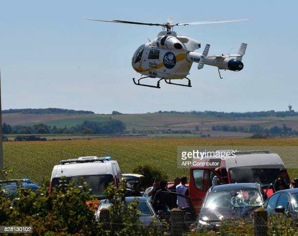 TOPSHOT An helicopter of the emergency medical assistance SAMU arrives on the site after the police arrested a suspect on the A16 motorway near...