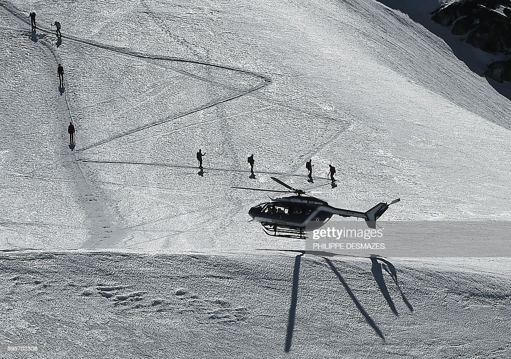 An helicopter of the French Gendarmerie lands on August 25 on the normal way for climbing to the MontBlanc peak in Chamonix eastern France / AFP /...