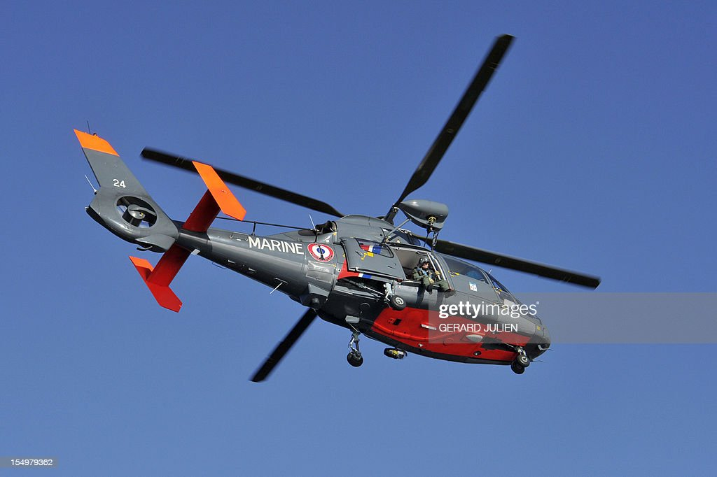 An helicopter of the French navy flies over the Porquerolles island, southeastern France on October 29, 2012 to search a 12-year-old British boy, who disappeared on October 27. Sixty soldiers and three civil security dog-handlers from Brignoles are paricipating in the search. AFP PHOTO GERARD JULIEN