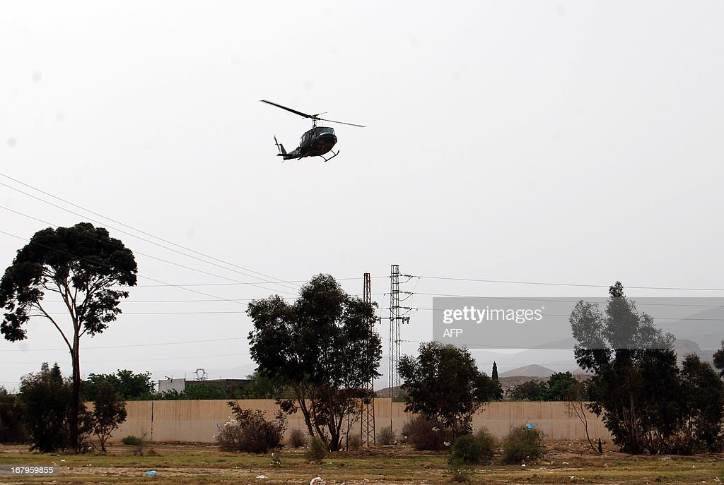 An helicopter of Tunisian army patrols during the search operations for a jihadist group hiding out near the Mount Chaambi, a border region with Algeria on May 3, 2013. Tunisia's army pressed its hunt for jihadists, an operation in which 15 security force members have been wounded, the interior ministry said.
