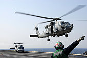 An HH-60H Sea Hawk helicopter takes off from USS Ronald Reagan.