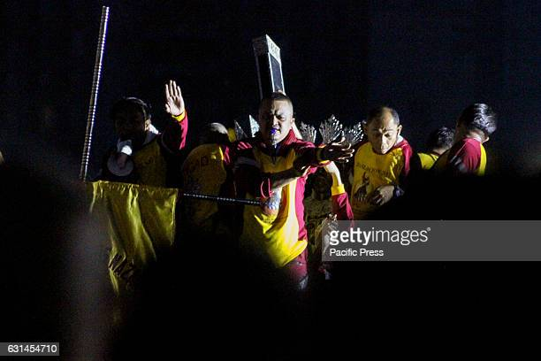 GRANDSTAND MANILA NCR PHILIPPINES An Hijos del Nazareno directs the crowds of Mamamasan who are pulling the andas of the Black nazarene during the...