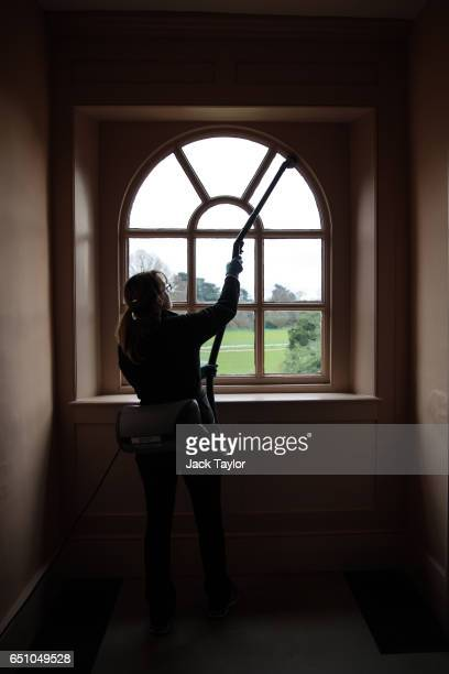An Historic Royal Palaces preventive conservator poses with a vacuum cleaner in a hall in Kew Palace at Kew Gardens in April on March 8 2017 in...