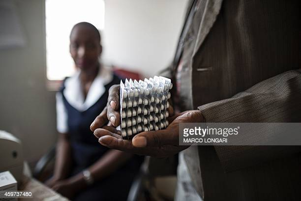 An Hiv positive patient is given a month worth of medication at the Thyolo District hospital during a routine antiretroviral consultation on November...
