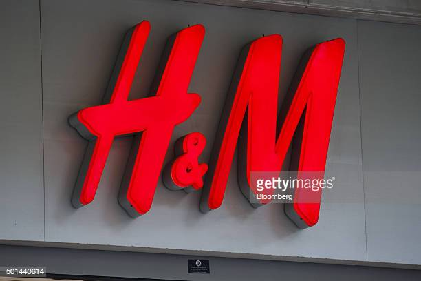 An HM logo sits on display above the entrance to a Hennes Mauritz AB store in San Sebastian Spain on Tuesday Dec 15 2015 Spain is facing a watershed...