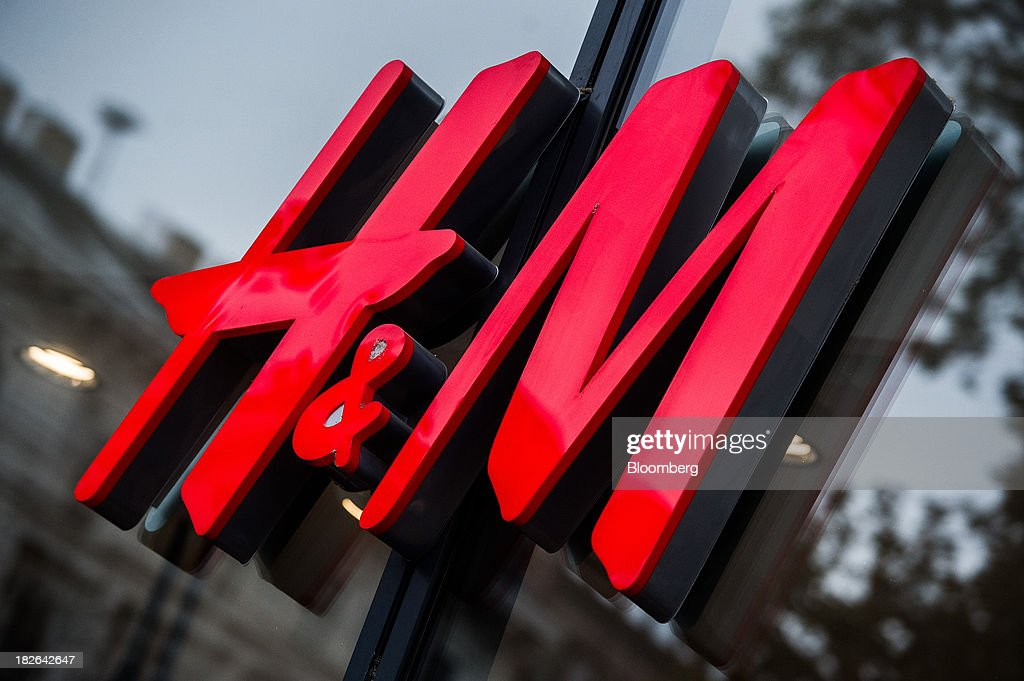 An H&M logo sits on display outside a Hennes & Mauritz AB (H&M) fashion store in Budapest, Hungary, on Wednesday, Oct. 2, 2013. 'The retail sales environment in Europe, especially in Spain, has become less challenging in the last few weeks, while the weather overall has also been more stable,' Anne Critchlow, a London-based analyst at Societe Generale, said. Photographer: Akos Stiller/Bloomberg via Getty Images