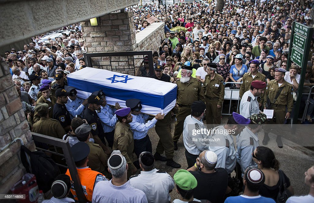 An honor guard caries the coffin of Israeli Lt. Hadar Goldin during his funeral on August 3, 2014 in Kfar-saba, Israel. Goldin was thought to have been captured during fighting in Gaza, but was later declared killed in action by the Israeli Defence Force (IDF).