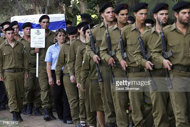 An honor guard leads the coffin of Israeli army reservist Noam Goldman into the military cemetery for his funeral August 10 2006 in the central...