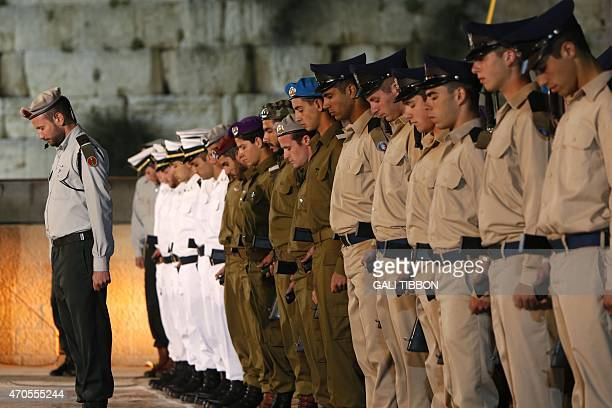 An honor guard of Israeli soldiers with their rifles stands to attention during a one minute siren during a state ceremony at the Western Wall in...