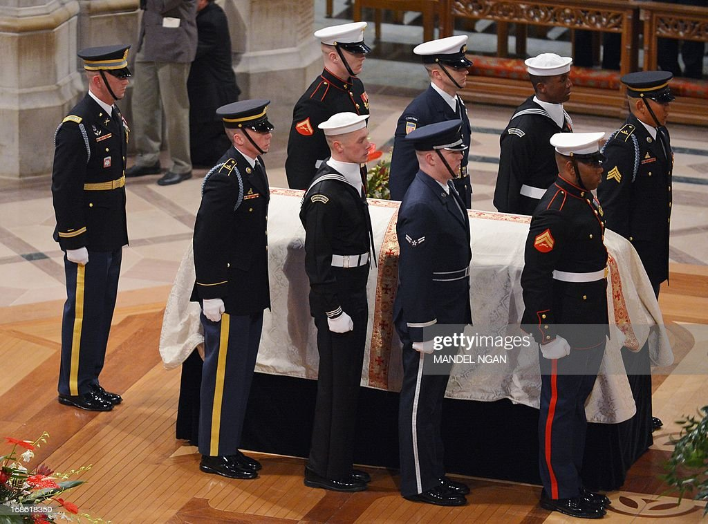 An honor guard stands next to the casket bearing US Senator Daniel Inouye on December 21, 2012 during his funeral in the National Cathedral in Washington, DC. The Hawaii Democrat was the longest-serving senator at the time of his death Monday at age 88. AFP PHOTO/Mandel NGAN